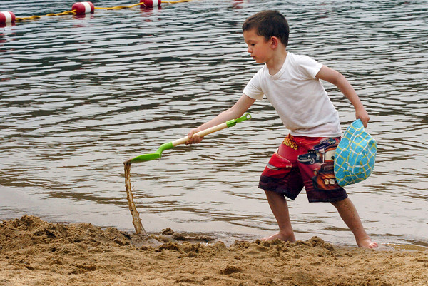 Amesbury: Riley Stevens, 4, digs a hole along the shoreline at Lake Gardner Beach on Wednesday afternoon. He was there with his mom, Kristi, of Amesbury, and has been visiting the beach since he was six months-old. Bryan Eaton/Staff Photo