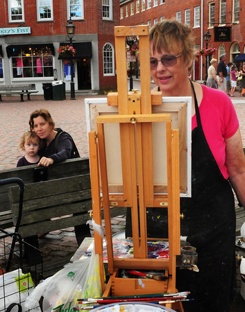 Newburyport: Nieb Witnauer, 3, took an interest in painter Lynne Schulte, who was painting the top of the Custom House Museum, while she and her mother, Jennifer, were in Newburyport's Market Square yesterday afternoon. Nieb's father, Dennis, is also a painter and the family lives in Newburyport and Schulte is from Georgetown. Bryan Eaton/Staff Photo