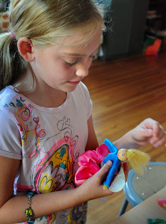 Newburyport: Ellie Becker, 8, puts different pieces onto a fairy doll she's making at the Kelley School Drop-In Center. The fairy project was taught by Elizabeth Golz Rush all week where the children made the parts to the doll and kept a fairy journal as well. Bryan Eaton/Staff Photo