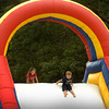Amesbury: Abby Arthur checks out the slope as Jacob Hoffman, both 3, of Amesbury slides down the blowup obstacle course at Amesbury Town Park on Thursday. They were at Amesbury Days' Kids Day in the Park. Bryan Eaton/Staff Photo