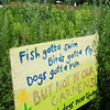 Amesbury: A good-natured sign appeals to dog owners near the Amesbury Community Gardens at Battis Farm watch their dogs to keep them from the garden area. The town farm, which houses the gardens, is also a very popular spot for dog owners with several trails, some running along Lake Gardner. Bryan Eaton/Staff Photo