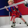 Newburyport: Colin RIchmond, 7, tries out the endless hockey treadmill at Eddie Hill's Hockey Clinic at the Graf Rink. Bryan Eaton/Staff Photo