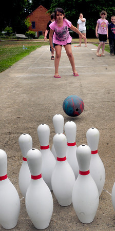 Amesbury: Nevaeh Al-Sarabi, 7, of Amesbury tries her luck at bowling during Amesbury Days' Kids Day in the Park on Thursday. Staff from the town's recreation department had several activities set up for children. Bryan Eaton/Staff Photo