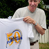 Newburyport: Yankee Homecoming road race director Jon Pearson shows off this year's t-shirt. Bryan Eaton/Staff Photo