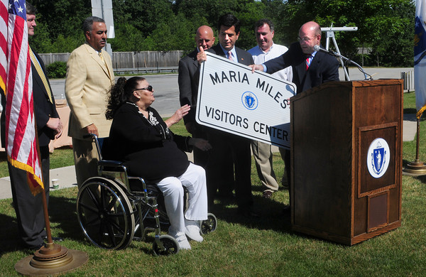Salisbury: Jeff Mullen, CEO of Mass. Department of Transportation, right, hands Maria Miles a sign for her to keep at an event that was something of a rededication of the Visitors Center in Salisbury which reopened yesterday after being closed last October due to budget cuts. From left, Neil Harrington, Salisbury town manager, Sheriff Frank Cousins, Rep. Michael Costello, Sen. Steven Baddour, Bill Piercey of North of Boston Convention and Visitors Bureau and Mullen. Bryan Eaton/Staff Photo