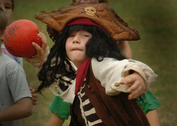 Amesbury: Matt Proctor, 8, hurls a ball during a game of Cannonball at the Amesbury Recreation Department's Summer Program yesterday. The youngster was dressed as a buccaneer as they were having Pirate's Day. Bryan Eaton/Staff Photo