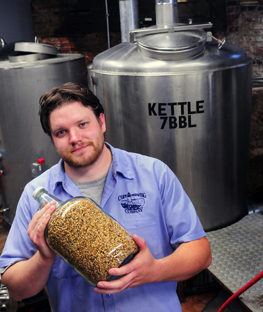 Amesbury: Sean Cody of Cody Brewing in downtown Amesbury, holding a jar of barley which he grinds himself, will be one of the featured brewers at Amesbury Days Brew Fest tonight. Bryan Eaton/Staff Photo