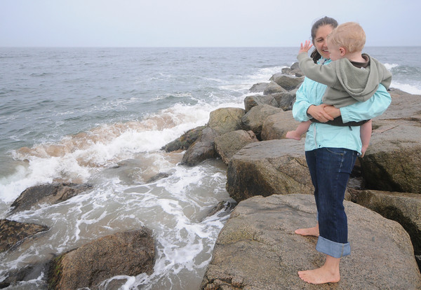 newbury: Owen Sinclair, 2, of Reading waves to the waves on Plum Island  as he is being held by his freind Leigh Hartwell Wednesday afternoon. Jim Vaiknoras/Staff photo