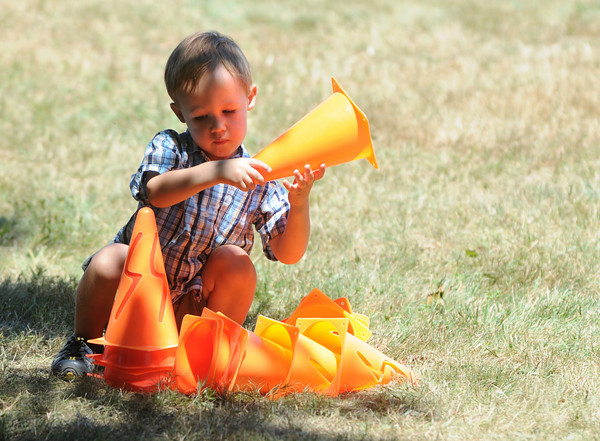 Newburyport: Mason Varay of Newburyport stacks athletic cones at Yankee Homecoming's Family Day at Maudslay Saturday afternoon.  Jim Vaiknoras/Staff photo