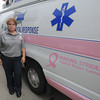 Newburyport. Elisabeth  Maisonet of AMR  poses with a ambulance that was dedicated to fellow employee Alicia Denisco, who has been battling cancer for six years, had  an ambulance her, which features a pink stripe in honor of breast cancer awareness. Jim vaiknoras/Staff photo
