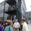 Newburyport:Mark Moquin, President of the Newburyport Affordable Housing Corporation talks with local residence at the  Titcomb and Woodland affordable housing project ribbon cutting Friday morning in Newburyport. Jim Vaiknoras/Staff photo