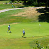 Wenham: A group of golfer prepare to putt on the 12th green at Wenham Country Club in Wenham. Jim Vaiknoras/Staff photo