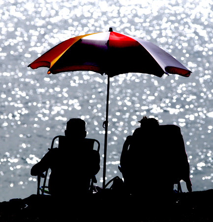 Salisbury: Barry and Marcia Connolly enjoy a day at the Salisbury Beach Saturday morning. Jim Vaiknoras/Staff photo