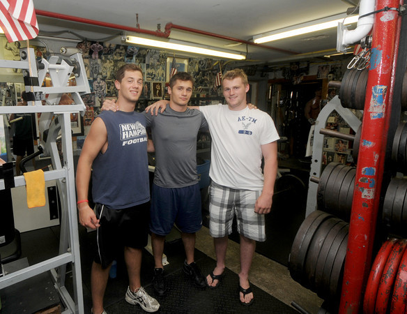 Amesbury:Dave Freeman, Derek Freeman, and Billy Eiserman pose wwhile working out at the Hard Knocks. The trio  are all going to run the Yankee Homecoming 10-mile together to raise money for the Gulf Coast oil spill disaster relief effort.Jim Vaiknoras/Staff photo