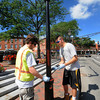 Newburyport:DPW workers  Jimmy Riley and Shea Quill paint the lamppost in Market Square FRiday morning. The poles were first covered in a flat red primer the painted black. Jim Vaiknoras/Staff photo