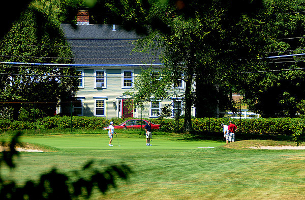 Wenham: A group of golfers approach the 1st green at Wenham Country Club in Wenham. Jim Vaiknoras/Staff photo