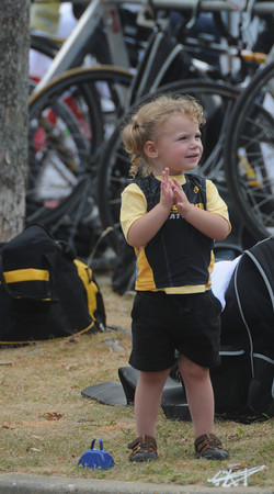 Amesbury: Mackenzie Dion, 2, cheers on participants at Lake Gardner in Amesbury for the Amesbury Dam Triathlon Saturday morning. Jim Vaiknoras/Staff photo