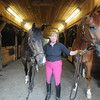 Georgetown:Cindi Wylie of teh Rosebrook Farm in Georgetown, poses with 2 of her horses, Rudy , left and Joey, the two, who are in competion  this weekend were stranded in Europe due to volcanic activity. Jim Vaiknoras/Staff photo