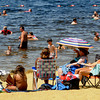 Amesbury:People flocked to Lake Gardner in Amesbury Sunday to catch some sun and cool off. Jim Vaiknoras/Staff photo