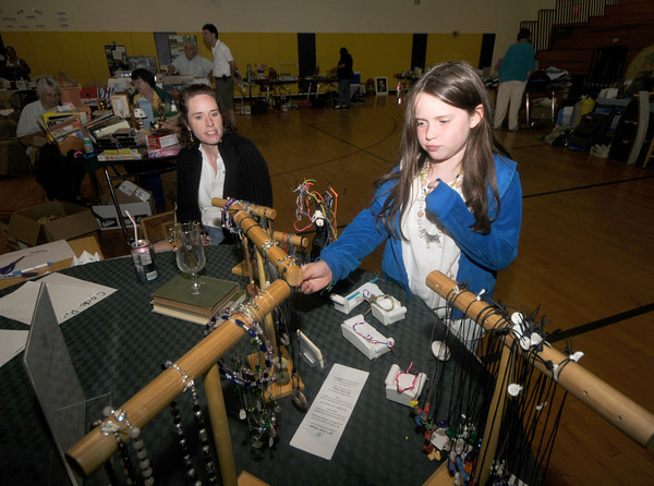Newbury: Valerie Hermanson of 360 North Designs and her daughter Katie sell jewelry at the Council of Aging yard sale at the Newbury elementary School Saturday. Jim Vaiknoras/Staff photo