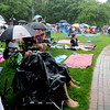 Newburyport: Heavy rain falls on the crowd at the Riverfront Festival in Market Landing Park in Newburyport Saturday. Despite the rain, which finally ended, the day long event continued through the early evening. Jim Vaiknoras/Staff photo