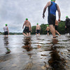 Amesbury: Athletes enter Lake Gardner in Amesbury for the Amesbury Dam Triathlon Saturday morning. Jim Vaiknoras/Staff photo