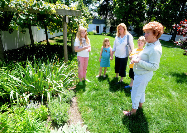 Amesbury: Rosemarie Rodie shows off the herb garden at the Whittier home in Amesbury to Karen Parker and her kids Louren, 10,  Ryan, 8, and Michelle, 8, at their open house Saturday. Jim Vaiknoras/Staff photo