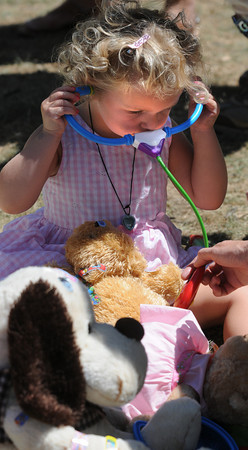 Newburyport: Elie DeGrano, 2, performs a few medical procedures at the Anna Jaques Stuffed Animal Clinic at Yankee Homecoming's Family Day at Maudslay Saturday afternoon.  Jim Vaiknoras/Staff photo