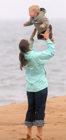 newbury: Owen Sinclair, 2, of Reading is tossed in the air by his freind Leigh Hartwell on Plum Island  Wednesday afternoon. Jim Vaiknoras/Staff photo