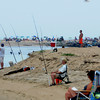 Newburyport: Fishermen line the mouth of the Merrimack River at Plum Island Point. Jim Vaiknoras/Staff photo