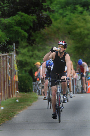 Amesbury: David Harding begins the cycling section at the Amesbury Dam Triathlon at Lake Gardner in Amesbury Saturday morning. Jim Vaiknoras/Staff photo