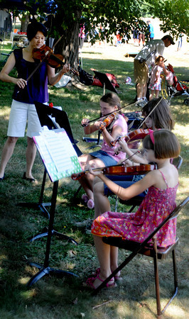 Newburyport: Megumi Sasaki of the Musical Suite in Newburyport performs with her Spring Ensemble — Nicole Stolarski, Cecilia Smith and Emma Buxbaum — at Yankee Homecoming's Family Day at Maudslay Saturday afternoon.  Jim Vaiknoras/Staff photo