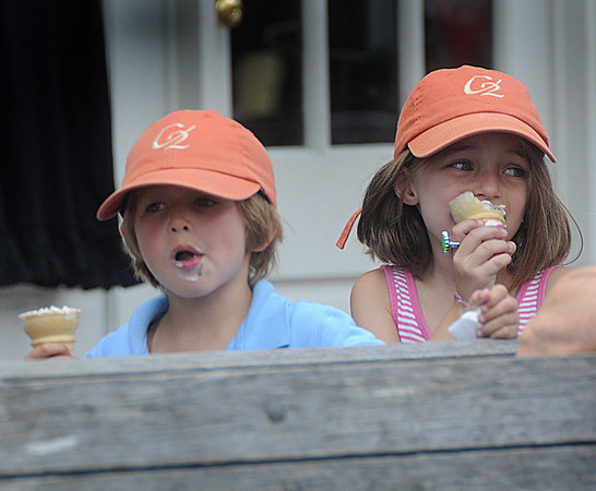 Newburyport: Riley Clarke, 6, and her brother Max, 4, of Hamilton find a way to cool off as they enjoy cones of Oreo ice cream in Market Square in Newburyport Sunday afternoon. Jim Vaiknoras/Staff photo