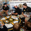 Byfield:  Bruin's prospects Ryan Donald, Jared Knight, and Max Suave read Dino-Hockey in a Bruin's Reading room at the Newbury Library Friday. The library won the themed furniture as part of the Bruin's summer reading program. Jim Vaiknoras/Staff photo