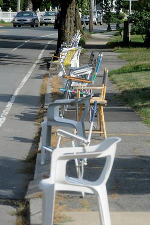 Newburyport: Chairs line High Street near Rawson Lane in anticipation of the Yankee Homecoming Parade Sunday. Jim Vaiknoras/Staff photo