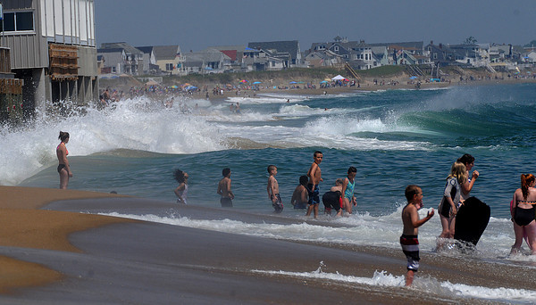 Salisbury: High surf pounds Salisbury Beach Sunday morning.Jim Vaiknoras/Staff photo