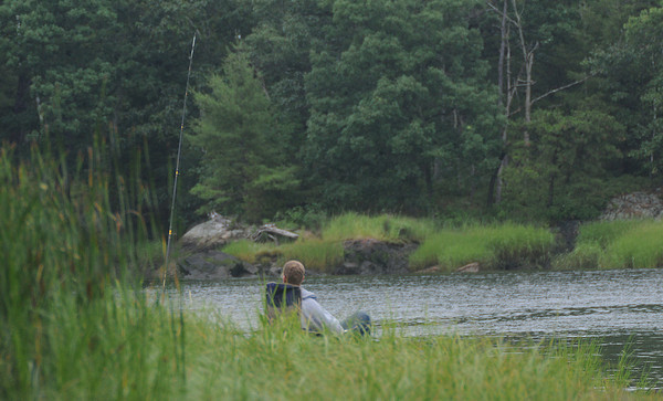 Amesbury: A man relaxes as he fishes of Deer Island in Amesbury Wednesday night. Jim Vaiknoras/Staff photo