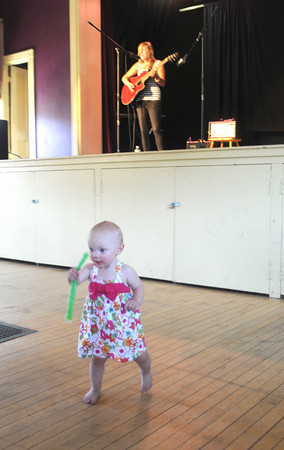 Byfield: Lyndsay Bowen, 2, dances to the music of Kelly Nicole at a fundraiser at Byfield town hall Saturday hosted by  Jarvisual to benefit the Community United Methodist Church Byfield MA and the Amesbury All Saints' Anglican Church. Every year both churches team up together and go on a mission trip to Maine where they fix up homes. the event lasted all day and featured many regional acts. Jim Vaiknoras/Staff photo