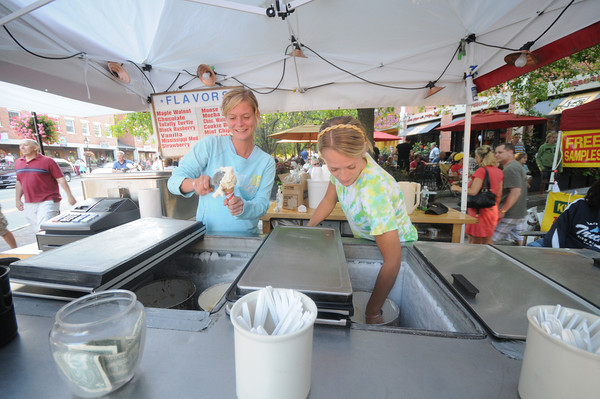 Newburyport: Sisters Joanna and Janey Daley of West Newbury serve ice cream in downtown Newburyport during Yankee Homecoming. Jim Vaiknoras/Staff photo