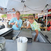 Newburyport: Sisters Joanna and Janey Daley of West Newbury serve ice cream in downtown Newburyport during Yankee Homecoming. Jim Vaiknoras/Staff photo