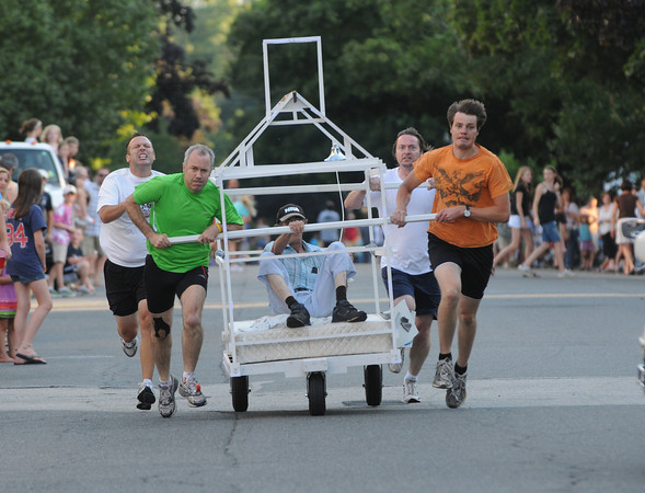 Newburyport: The Old South Church Runners sprint down Federal Street in the Yankee Homecoming Bed Race in Newburyport Thursday night. Jim Vaiknoras/Staff photo