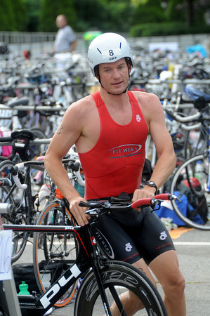 Amesbury: Dean Phillips transitions to cycling at Lake Gardner in Amesbury for the Amesbury Dam Triathlon Saturday morning. Jim Vaiknoras/Staff photo