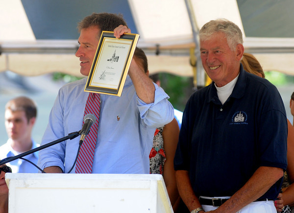 Newburyport: U.S. Sen. Scott Brown presents a plaque to his father and former Yankee Homecoming  Chairman C. Bruce Brown commemorating his 25 years of service to the Jimmy Fund at Old-Fashioned Sunday on the Bartlet Mall In Newburyport. Jim Vaiknoras/Staff photo