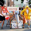 Newburyport: The Simply Sweet 1 makes it's way down Federal Street in the Yankee Homecoming Bed Race sprint in Newburyport Thursday night. Jim Vaiknoras/Staff photo