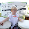Newburyport: Ruby Rose Edmond tries out the drums at the Zach Field Drum Studio Tent at Yankee Homecoming's Family Day at Maudslay Saturday afternoon.  Jim Vaiknoras/Staff photo