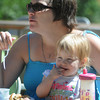 Amesbury: kate Richards and her daughter Sidney, 20 months, enjoy breakfast at the annual Pancakes Under the Pines at Amesbury Town Park Sunday morning. Jim Vaiknoras/Staff photo