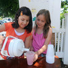 Newburyport:Anjelica Soares, left, and Sadie Fisher both 9, sell lemonade on Fruit Street in Newburyport Friday morning. The two are hoping to make enough money to each get a puppy. JIm Vaiknoras/Staff photo