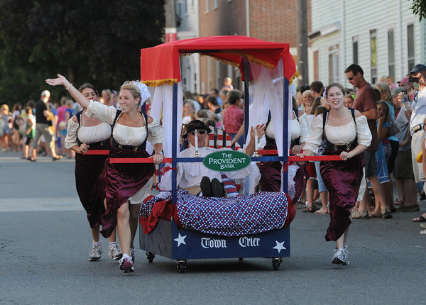 Newburyport: The Provident Bank entry makes it's way down Federal Street in the Yankee Homecoming Bed Race in Newburyport Thursday night. Jim Vaiknoras/Staff photo