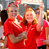Newburyport: Holly Jakobson and Amanda Atherton cheer on the bed from Bob Lobster at the Yankee Homecoming Bed Race in Newburyport Thursday night. Jim Vaiknoras/Staff photo
