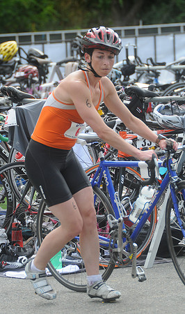 Amesbury: Shannon Phillips makes the transition from swimming to cycling at the Amesbury Dam Triathlon at Lake Gardner in Amesbury Saturday morning. Jim Vaiknoras/Staff photo